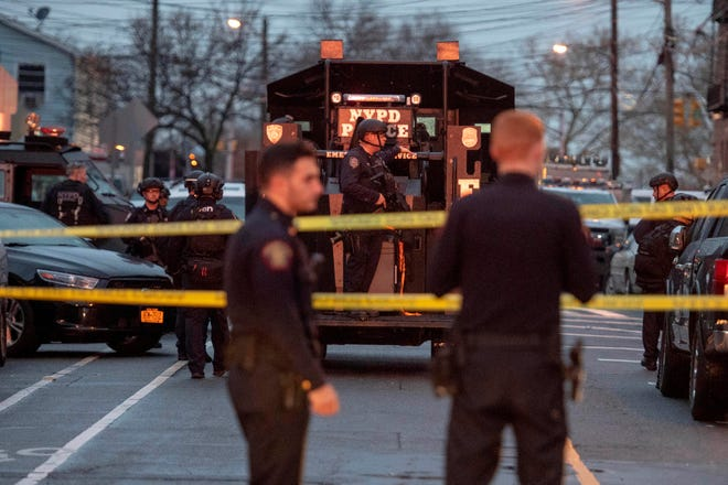 Law enforcement in the Greenvile section of Jersey City where an officer and five others were killed in a shooting on Tuesday, December 10, 2019.