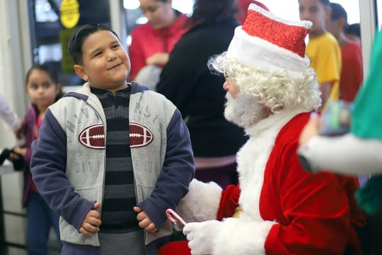 This youngster shared his Christmas wish with Santa during the Luna County Shop with a Cop on Saturday at the Deming Walmart Super Center.
