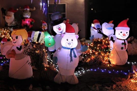 This festive Christmas light display is located at 3346 Ridgeline Dr.