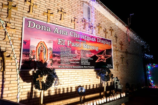 The Martinez family decorates their house in thousands of lights and a special display dedicated to the 22 victims of the Walmart shooting in El Paso on Monday, Dec. 9, 2019.