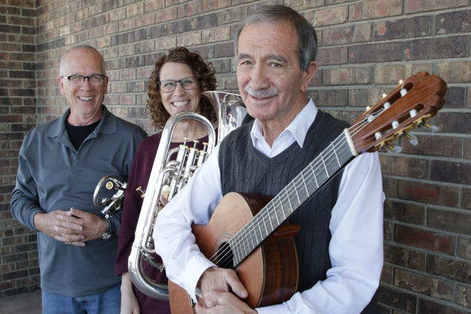 Mick Hesse, left, Connie Schulz and Mario Armandariz are part of the Best Brass of Christmas group performing this weekend in Farmington.