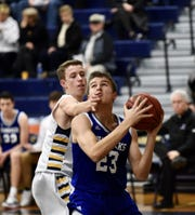Catholic Central senior guard Tyler Martinez goes for the hoop in the paint.