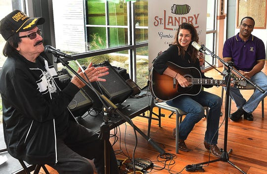 "Warren Storm and Yvette Landry perform at the St. Landry Parish Visitiors Center and sign CD's and copies of the book ""Taking the World by Storm."" Tourist Center executive director Herman Fuselier is shown in the background."