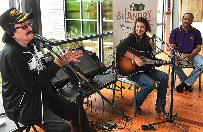 """Warren Storm and Yvette Landry perform at the St. Landry Parish Visitiors Center and sign CD's and copies of the book """"Taking the World by Storm."""" Tourist Center executive director Herman Fuselier is shown in the background."""