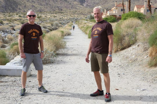 Volunteer Trail Rangers Keith Kincaid and Jim Flanagan station themselves at the South Lykken Trailhead in Palm Springs, Calif., on December 10, 2019. They volunteer their time to help protect the bighorn sheep by informing hikers of the prohibition of dogs on some trails in Palm Springs.