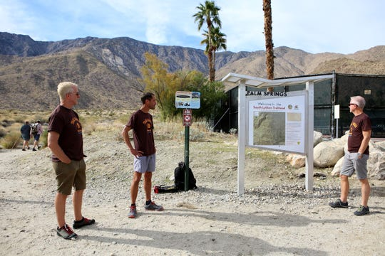 Volunteer Trail Rangers Jim Flanagan, left, Scott Collins and Keith Kincaid station themselves at the South Lykken Trailhead in Palm Springs, Calif., on December 10, 2019. They volunteer their time to help protect the bighorn sheep by informing hikers of the prohibition of dogs on some trails in Palm Springs.