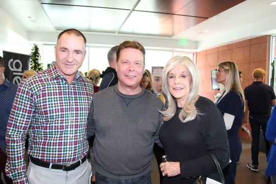 Lee Erwin, Contour Dermatology's executive director, posed with Geoff McIntosh and Cheryle Marr.
