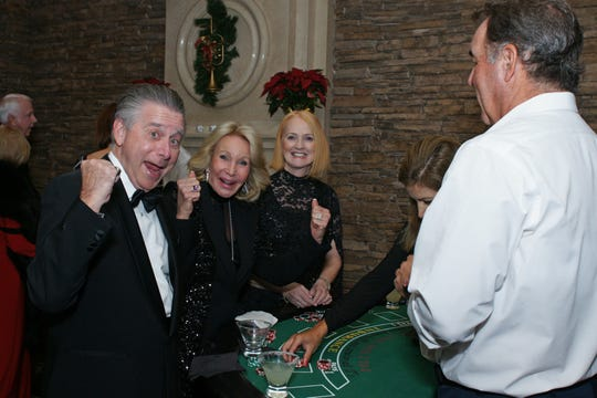 "Michael and Peggy Berk, with Georgia Lee Lang, had fun at the ""casino."""