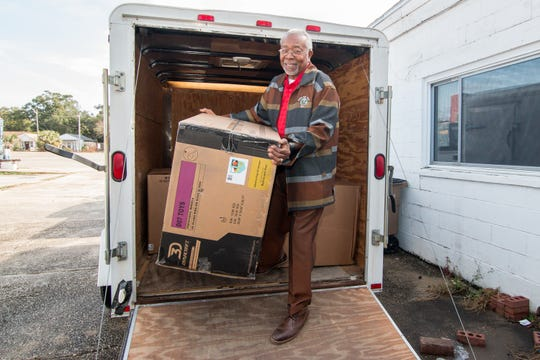 Rev. John H. Powell, president of Truth for Youth, unloads gifts on Monday, Dec. 9, 2019, that will be given out during the 27th annual Save Our Children Christmas Report Card Rally which aims to donate about 3,000 gifts to area children. The organization will have a charity event on Sunday, Dec. 15, at Chizuko, located at 506 W. Belmont St., to help raise money and gift donations.