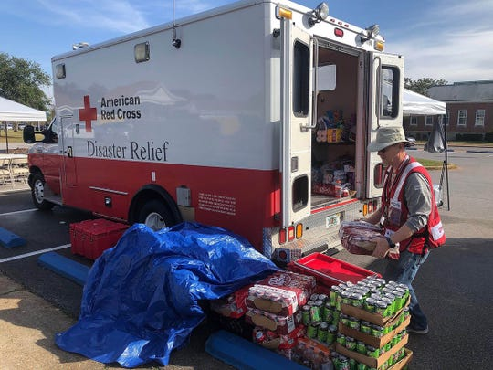 Duke Porritt, American Red Cross Northwest Florida volunteer, prepares drinks as part of relief efforts at NAS Pensacola following a deadly shooting on Dec. 6, 2019. The Red Cross helped to feed law enforcement, federal agents and base personnel.