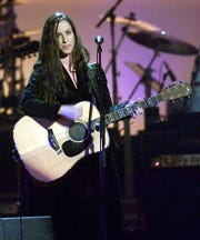 """Alanis Morrissette performs during the concert called """"Come Together: A Night For John Lennon's Words And Music"""" at Radio City Music Hall 02 October 2001."""