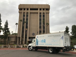An Iron Mountain truck sits outside the state Capitol in Phoenix. The Secretary of State's Office began moving government files from a warehouse near the Capitol in 2017 to the company's facilities. But the current secretary of state, Katie Hobbs, says the arrangement is too expensive.