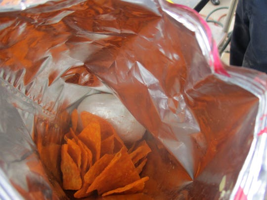 Customs officers stationed at the Lukeville port of entry seized nearly 2.5 pounds of fentanyl valued at $25,000 hidden inside a bag of chips and a container of shredded beef on Dec. 8, 2019.