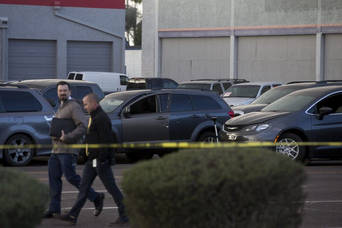 Police officers work the scene of a police shooting near the northwest corner of 43rd avenue and McDowell Road on Dec. 9, 2019. Two officers fired multiple rounds at a suspect involved in a deadly shooting in Glendale who had fled the scene before being apprehended by officers in Phoenix.