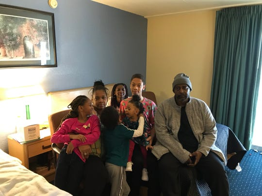 Kevin and Dee Smith with some of their boisteruos kids in a room at the Clarion Hotel. Khalil, 13, is holding 1-year-old Imyjah, who had the attention of 5-year-old Khadir, in green. Imari, 9, is behind Khalil, and 7-year-old Imyra is sitting next to her mom.