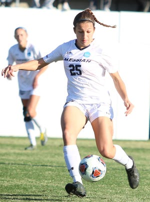 Dover High School graduate Brooke Firestone is seen here playing for the Messiah College women's soccer team.