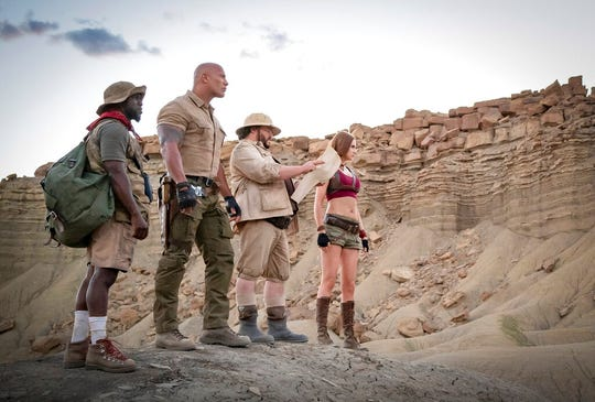 """From left, Kevin Hart, from left, Dwayne Johnson, Jack Black and Karen Gillan star in """"Jumanji: The Next Level."""" The movie opens Thursday at Regal West Manchester, Queensgate Movies 13 and R/C Hanover Movies."""