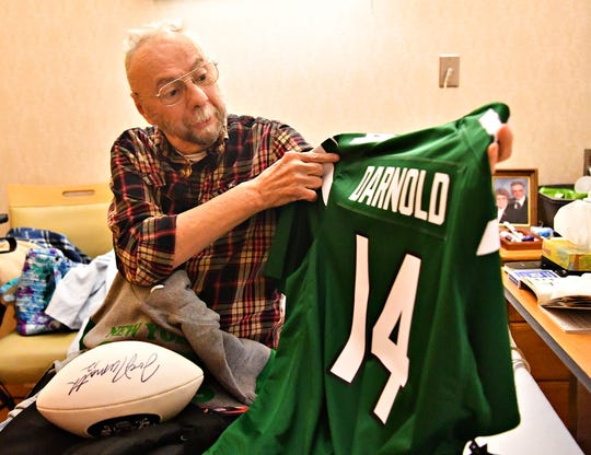 Heartland Hospice patient Jack Snyder examines his new New York Jets jersey at Manor Care Health Services - Kingston Court in Springettsbury Township, Tuesday, Dec. 10, 2019. Snyder, who was diagnosed with an untreatable form of lung cancer, has been a fan since the early 1960's, and will be attending the New York Jets vs Baltimore Ravens game on Dec. 12, courtesy of the Heart's Desire Program, which gives Heartland Hospice patients the chance to fulfill their wishes. Dawn J. Sagert photo