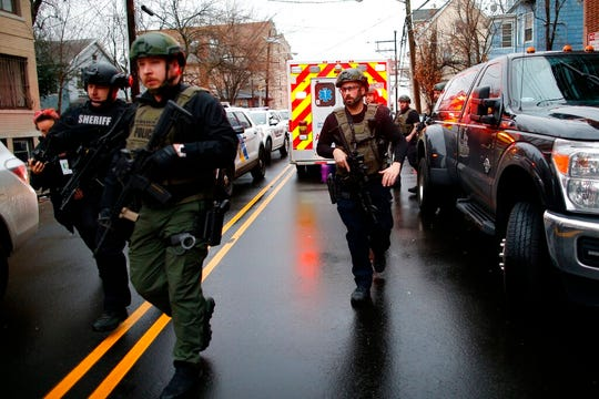 Law enforcement arrives at the scene following reports of gunfire, Tuesday, Dec. 10, 2019, in Jersey City, N.J.  AP Photo/Eduardo Munoz Alvarez)