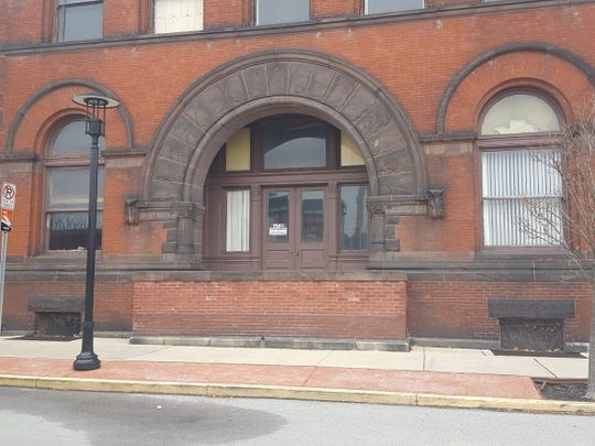 The west entrance of the Lighthouse Boy's Club containing brownstone.
