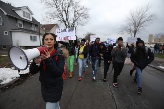 Madison Smith, one of the leaders of East High's student protest, turn around and head back towards  Main St.  from Ohio St.  The students marched with their signs against cutting teachers on Main St. Ohio St. and Culver Road before heading back to the school.