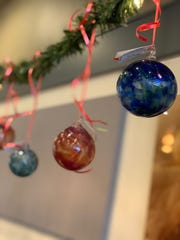 Glass Art Oregon has created over 150 unique glass ornaments for sale this month at The Sassy Onion Grill.