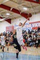 North Salinas freshman Daeja Hollands (2) rises up for a layup against Everett Alvarez.