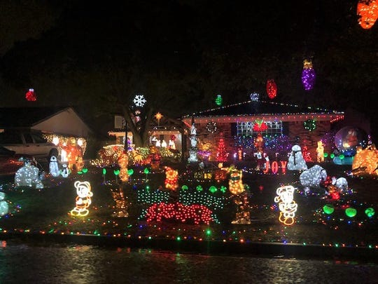 The yard at 3306 Cumberland Drive is a celebration of lights, from Disney characters to Santa's sleigh.