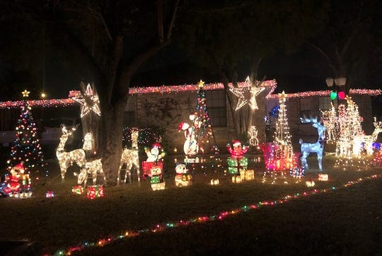 206 Lipan Drive has a yard covered with holiday displays including reindeer, polar bears and snow men.