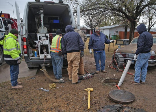 Workers with the City of San Angelo and Darnell Construction work on a sewer line that collapsed near North Magdalen and 6th Street in San Angelo on Tuesday, Dec. 10.