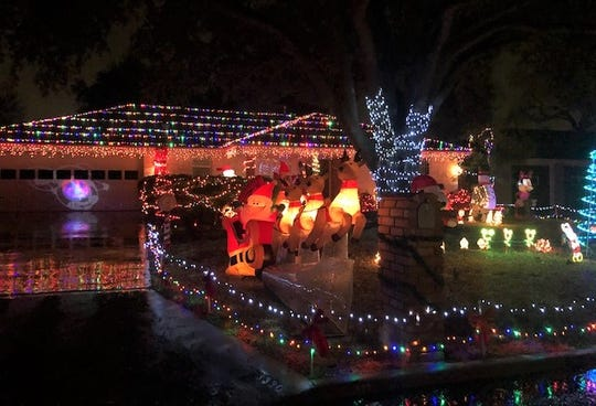 Lights display at 3330 Cumberland Drive with Snoopy, Mickey Mouse and Santa.