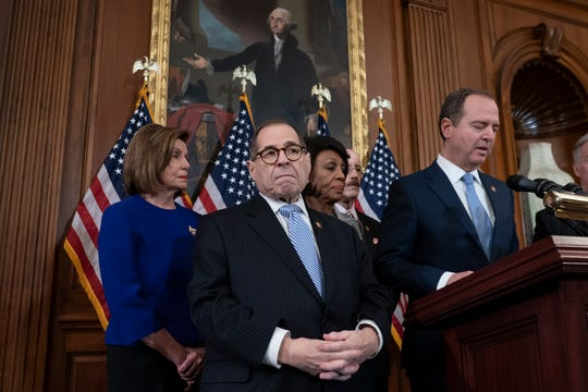 From left, Speaker of the House Nancy Pelosi, D-Calif., House Judiciary Committee Chairman Jerrold Nadler, D-N.Y., House Financial Services Committee Chairwoman Maxine Waters, D-Calif., House Foreign Affairs Committee Chairman Eliot Engel, D-N.Y., and House Intelligence Committee Chairman Adam Schiff, D-Calif., announce they are pushing ahead with two articles of impeachment against President Donald Trump — abuse of power and obstruction of Congress — charging he corrupted the U.S. election process and endangered national security in his dealings with Ukraine, at the Capitol in Washington, Tuesday, Dec. 10, 2019. (AP Photo/J. Scott Applewhite)