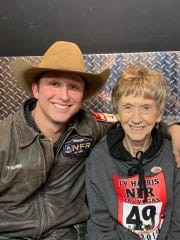 Ty Harris, left, was happy his grandmother Peggy Harris, right, was present to see him receive his belt buckle for winning Round 5 in tie-down roping at the National Finals Rodeo Dec. 9, 2019, at the Thomas & Mack Center in Las Vegas.