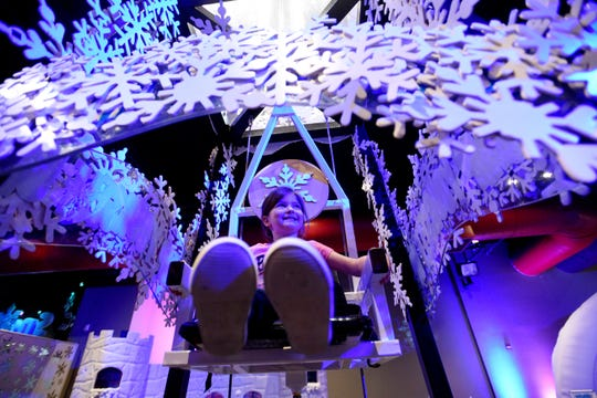 Ariana Seeondi has fun at Sno-Port: The Science and Wonders of Snowflakes on the first floor of Sci-Port Discovery Center.