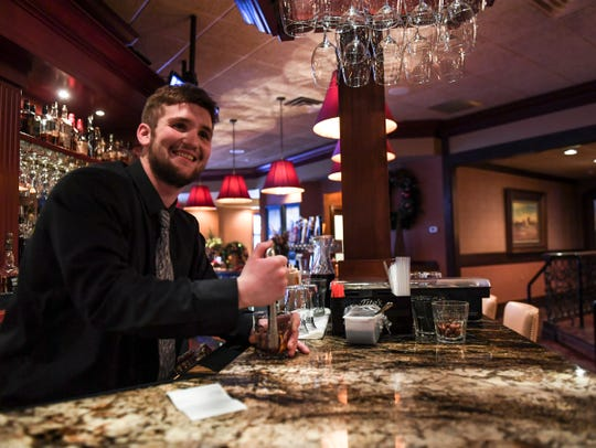 Bartender Hunter Shamatt makes an old fashioned cocktail on Tuesday, Dec. 10, 2019 at Minerva's.