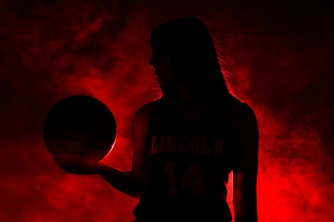 Lincoln's Emma Osmundson (14) poses for a portrait during basketball media day on Saturday, Dec. 7, 2019 at the Argus Leader.