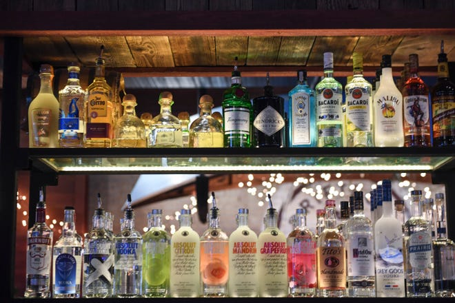 Bottles of alcohol line the bar on Tuesday, Dec. 10, 2019 at MacKenzie River.