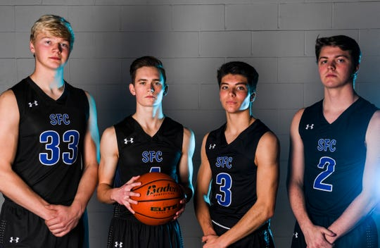 Sioux Falls Christian's Zach Witte (33), Carson Van Beek (4), Noah Van Stedum (3) and Carter Nelson (2) pose for a portrait during basketball media day on Saturday, Dec. 7, 2019 at the Argus Leader.