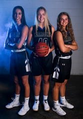 Sioux Falls Christian's Lexi Unruh (4), Lauren Tims (40) and Maddie DeJong (5) pose for a portrait during basketball media day on Saturday, Dec. 7, 2019 at the Argus Leader.