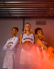 Washington's Ndjakalenga Mwenentanda (40), Sydni Schetnan (50) and Brielle Biteler (20) pose for a portrait during basketball media day on Saturday, Dec. 7, 2019 at the Argus Leader.