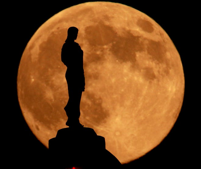 A statue of Ceres, Roman goddess of agriculture, is silhouetted against the rising moon as it stands on top of the Missouri State Capitol building Wednesday, Sept. 22, 2010  in Jefferson City, Mo. (AP Photo/Charlie Riedel)