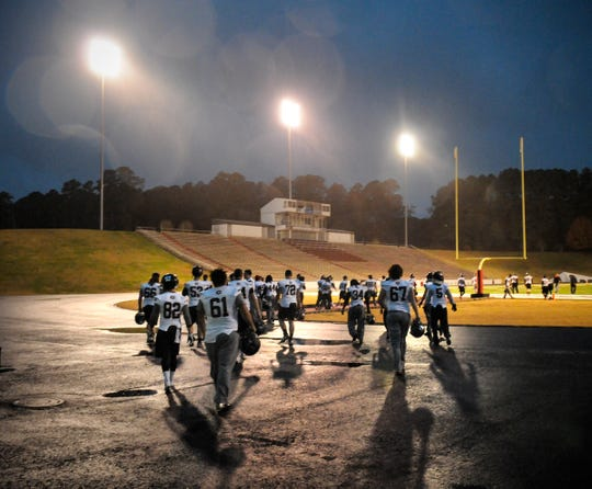 St. Cloud State players take the field in a light rain to practice Friday, Nov. 22, 2013, at Carpenter-Haygood Stadium in Arkadelphia, Ark. St. Cloud State won the game against Henderson State in the first round of the NCAA Division II Football Championship 40-35 to advance.