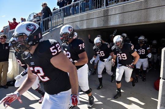 St. Cloud State players take the field before the start of a 2015 game between St. Cloud State and Minnesota-Crooskston at Husky Stadium in St. Cloud.