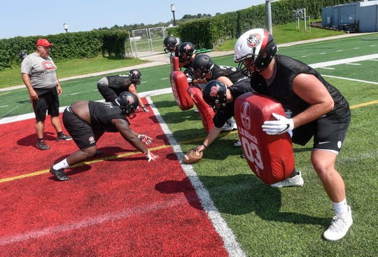 Players line up for a drill during practice Wednesday, Aug. 8, 2018, at Husky Stadium in St. Cloud.