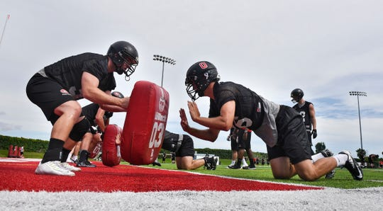 St. Cloud State players take part in a drill during a 2016 practice at Husky Stadium in St. Cloud.
