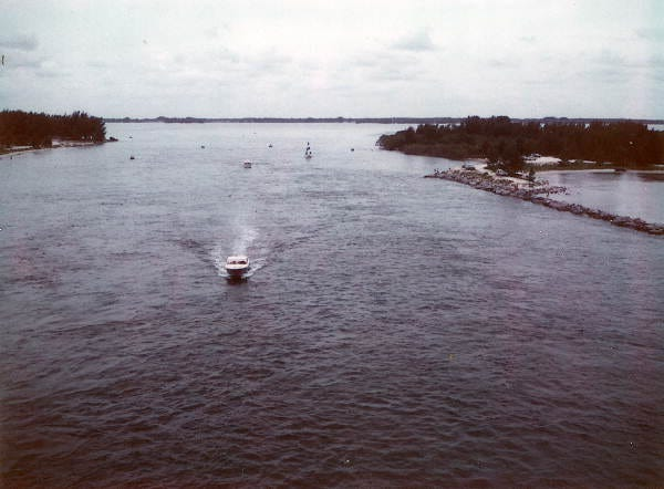 A boat cruises in the Sebastian Inlet in Indian River County, Fla., in 1970.