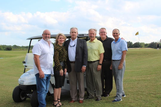 Dickerson Ultimate Drive Golf Tournament Committee members, from left, Jimmy Freitas, Roxanne Hall; Larry Dale, title sponsor; Howard T. Tipton, Douglas Baber and Mark Cammarene.