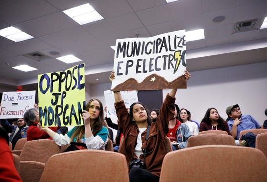 At a Dec. 10 El Paso City Council meeting, Lindsey De Haro and Alessandra Valenzuela of Sunrise El Paso protest the sale of El Paso Electric to the J.P. Morgan Chase-advised Infrastructure Investments Fund.