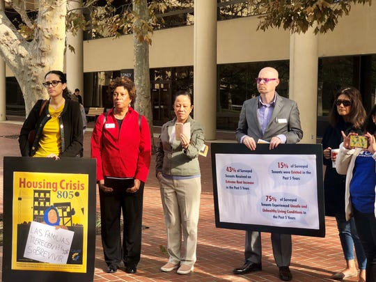 A group of about a dozen people attended CAUSE's press conference on the region's housing crisis, which showcased findings from the organization's new report on housing.