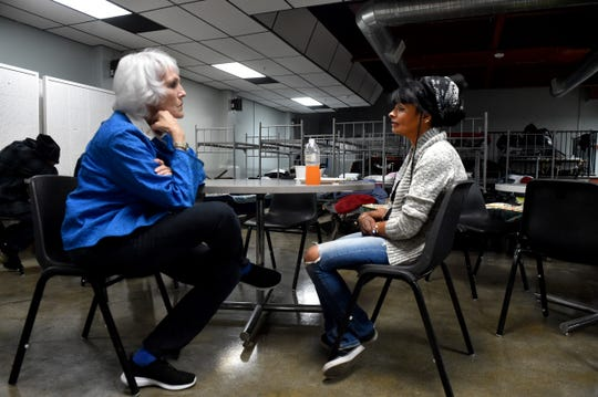 Kay Wilson-Bolton, director of SPIRIT of Santa Paula, speaks with Kitina Williams, a client at the organization's new shelter. The site was formerly a nightclub.
